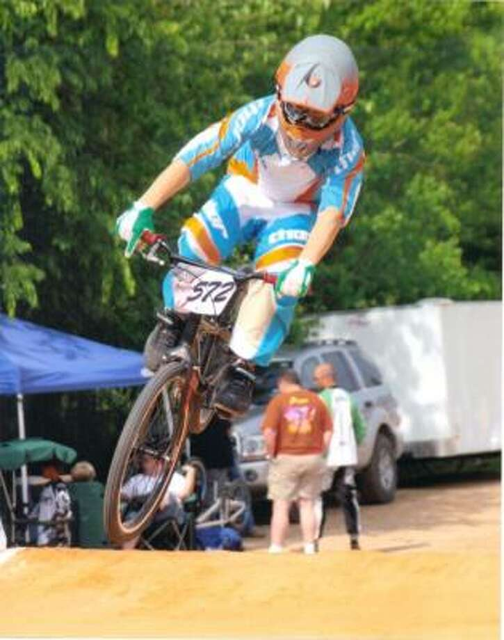 Edward Dorrian on his BMX bike going into the first turn at the Pearland Speedway in April. Photo: Handout, Bart Elkin