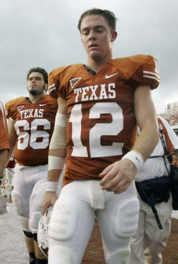 Former Texas Longhorns center Buck Burnette, left, posted a racial slur on his Facebook page that led to his dismissal from the team. Photo: L.M. Otero, AP
