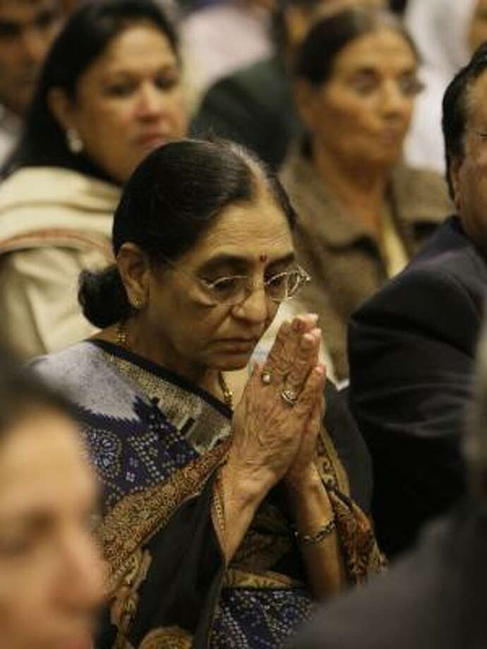 Virbala B. Patel attends a meeting of prayer and solidarity Sunday at Houston's India House cultural center. Speakers compared the attacks to the ones carried out on Sept. 11, 2001. Photo: MELISSA PHILLIP, CHRONICLE