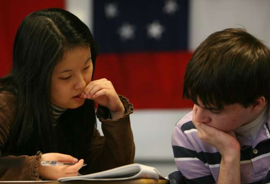 """Susan Xie and John Werner, members of the Seven Lakes High School Academic Decathlon team, practice for this weekend's competition. As part of the preparation, coach John Irish said, """"We are spending a lot of time reading, re-reading, re-re-reading."""" Photo: SHARÓN STEINMANN, CHRONICLE"""