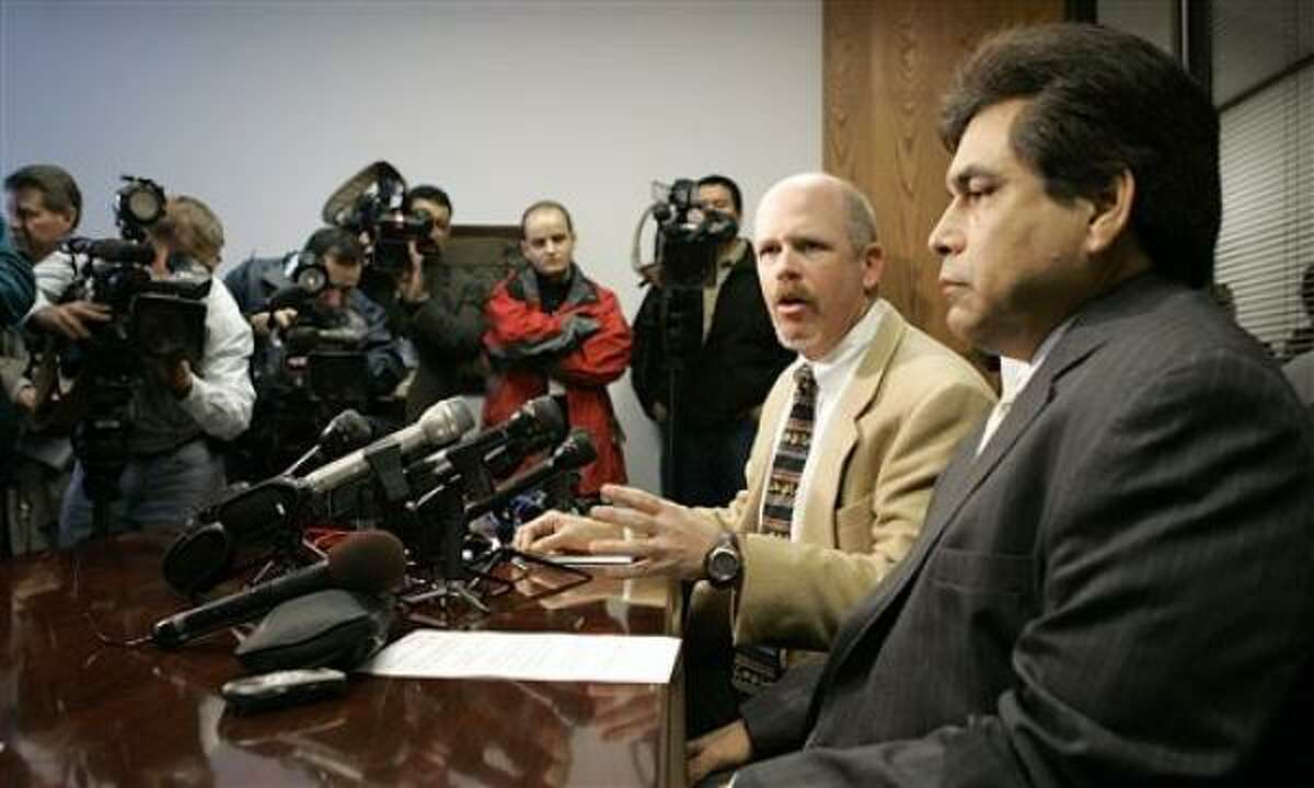 Texas Supreme Court Justice David Medina, right, and his attorney Terry Yates face the media Friday in Houston.