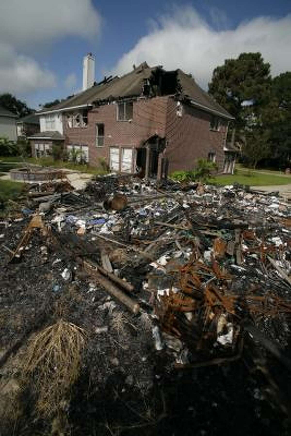 The house of Texas Supreme Court Justice David Medina, destroyed in a fire last year.