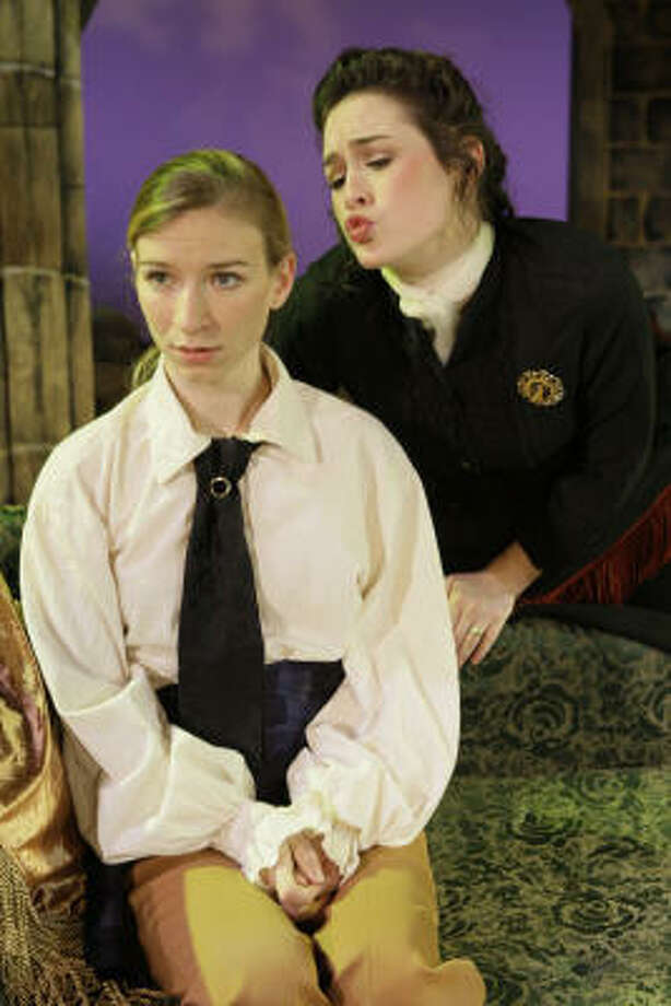 Viola (Natalie Arneson, left), disguised as her brother Sebastian, is distressed to discover that the Countess Olivia (Alison Luff) has fallen in love with her (uh, him) in this scene from Illyria, the musical version of Shakespeare's Twelfth Night, playing at the Texas Repertory Theatre Co. Photo: Melissa Phillip, Houston Chronicle