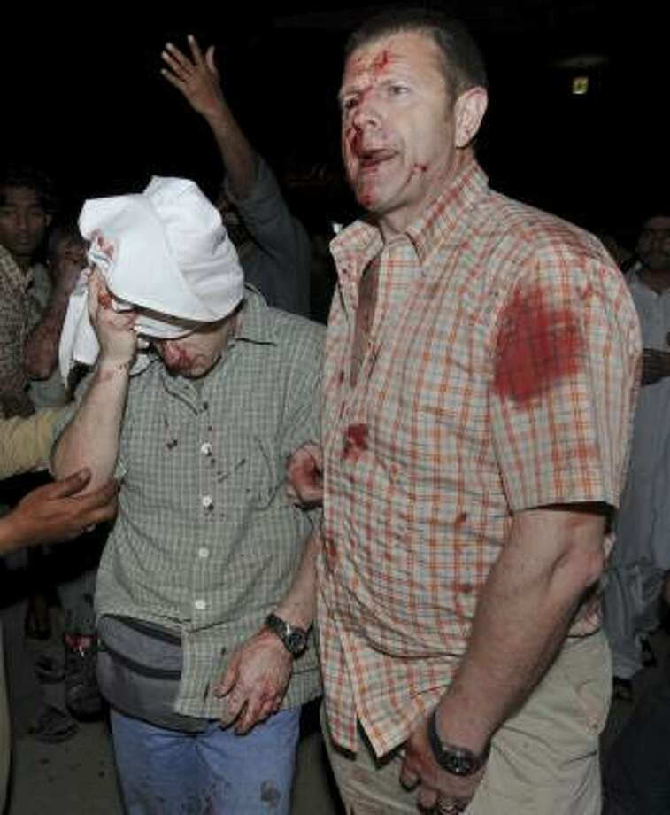 Two foreigners await treatment after being hurt in a Pakistan bombing. Photo: Str, ASSOCIATED PRESS