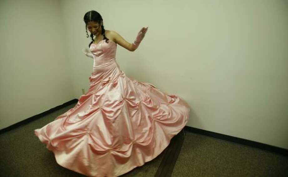 Jessie Felix, 16, from Lamar High School, twirls Sunday in her new dress, which she found through the Fairy Godmother Project. Photo: SHARÓN STEINMANN, CHRONICLE