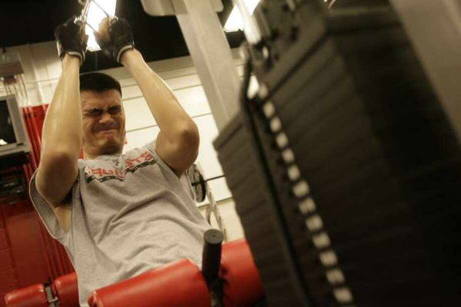 With plans to be ready for the Olympic Games this summer in Beijing, Yao Ming has begun intense training that he also hopes will help make him stronger next season with the Rockets. Photo: Julio Cortez, Chronicle