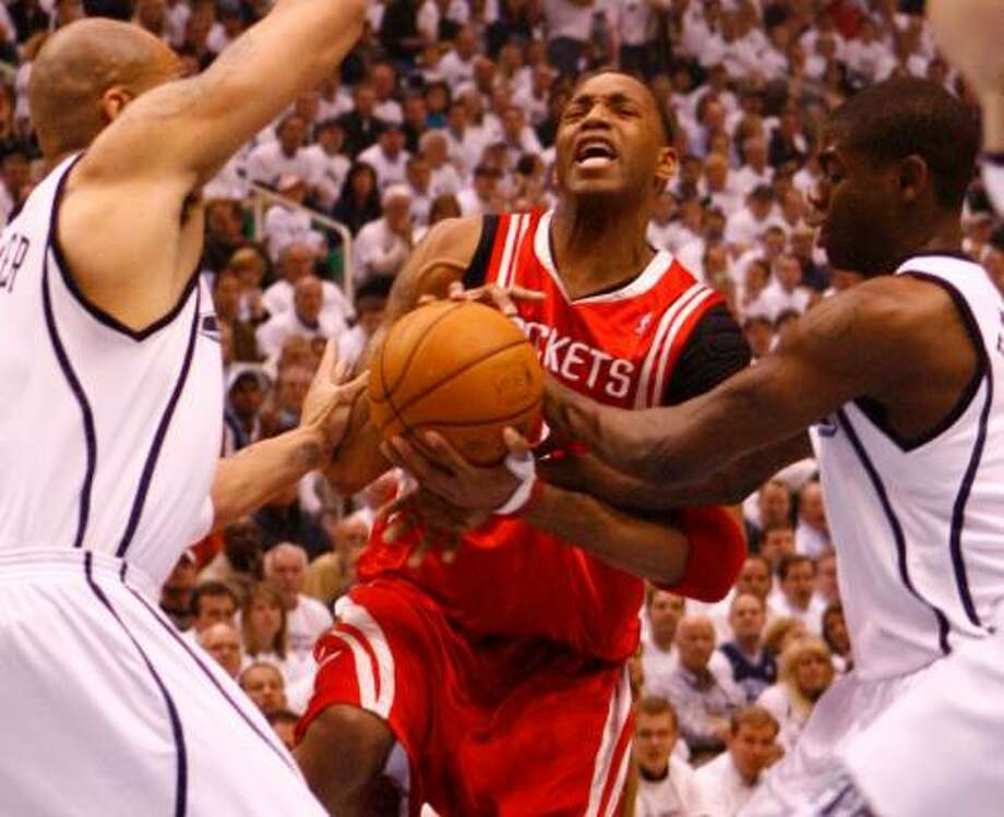 Tracy McGrady, center, is having trouble contending with several aggressive Jazz defenders. Photo: NICK De La TORRE, CHRONICLE