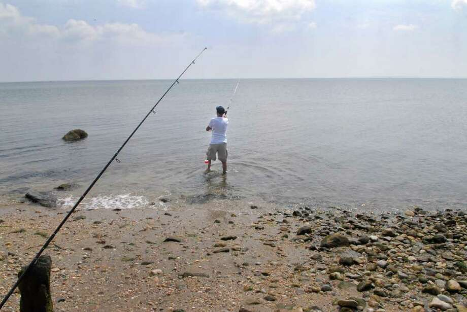 Felix Dzerneyko fishes for snapper at the public beach at the end of Fairview Ave in Stamford, Conn. on Monday August 8, 2011. Photo: Dru Nadler / Stamford Advocate Freelance