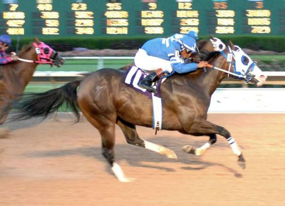 Sassys Tuffy, right, with Jose Alvarez in the irons, edges Diamond Tres Seis to win the Bank of America Texas Challenge Championship at Sam Houston Race Park on Saturday night. Sassys Tuffy won the 440-yard race in 21.64 seconds. Photo: SANDRA BECK, COADY PHOTOGRAPHY