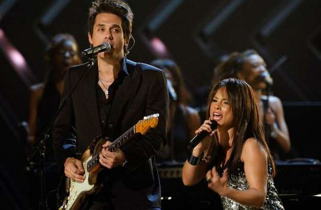 John Mayer stays busy recording, touring and collaborating, as he did with singer Alicia Keys in a performance for this year's Grammy awards. Photo: KEVIN WINTER, GETTY IMAGES