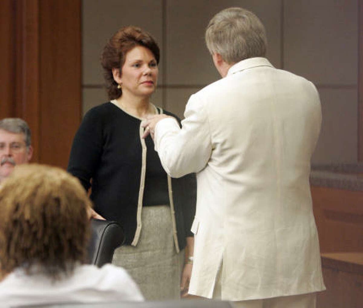 Continental flight attendant Maria Johnson, center, is questioned by defense attorney Rusty Hardin as the plaintiff Sharon Brown, lower left, watches Thursday, Aug. 7, 2008 in Houston.