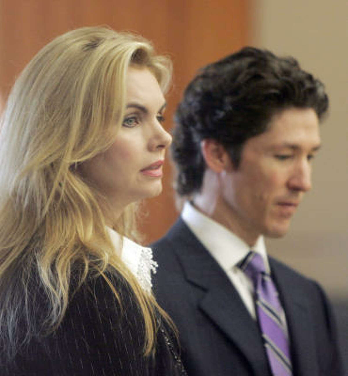 Victoria Osteen and her husband, evangelist Joel Osteen, wait in court during a break in testimony in her civil trial Thursday, Aug. 7, 2008 in Houston. Victoria, the co-pastor of Lakewood Church, is being sued by Continental flight attendant Sharon Brown, who says Osteen assaulted her on a plane.