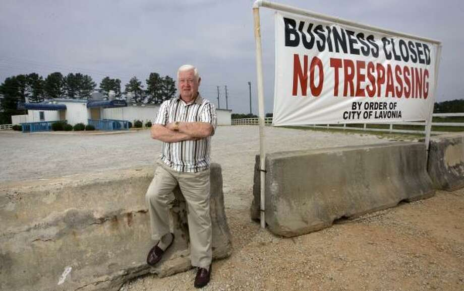 Mayor Ralph Owens stands outside Cafe Risque in Lavonia, Ga., which his city recently bought and shut down. Photo: JOHN AMIS, ASSOCIATED PRESS