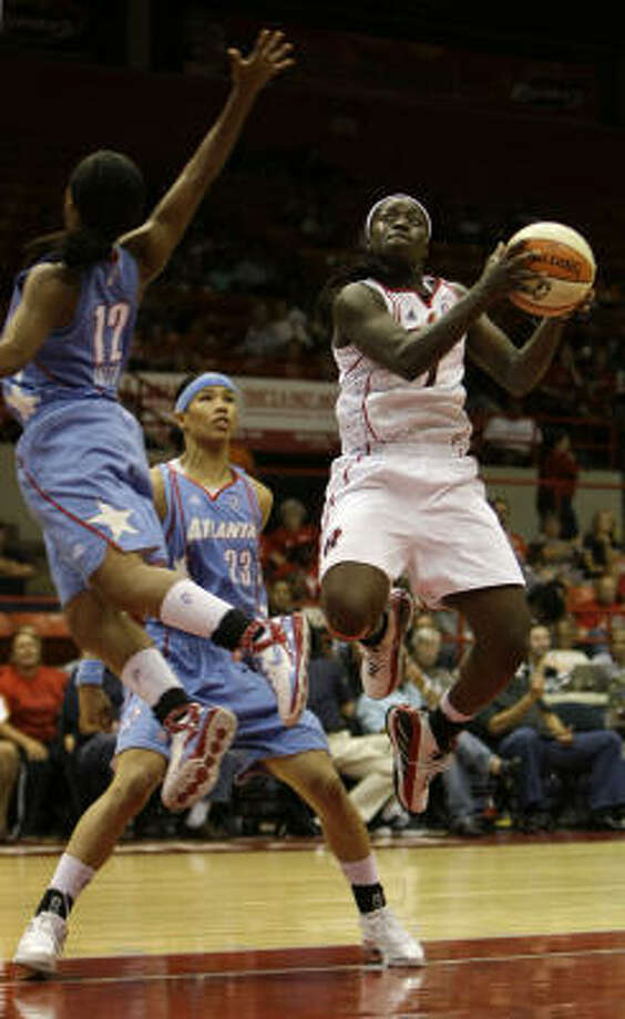 Matee Ajavon (1) joins Candace Parker on the all-rookie team. Photo: Karen Warren, Chronicle