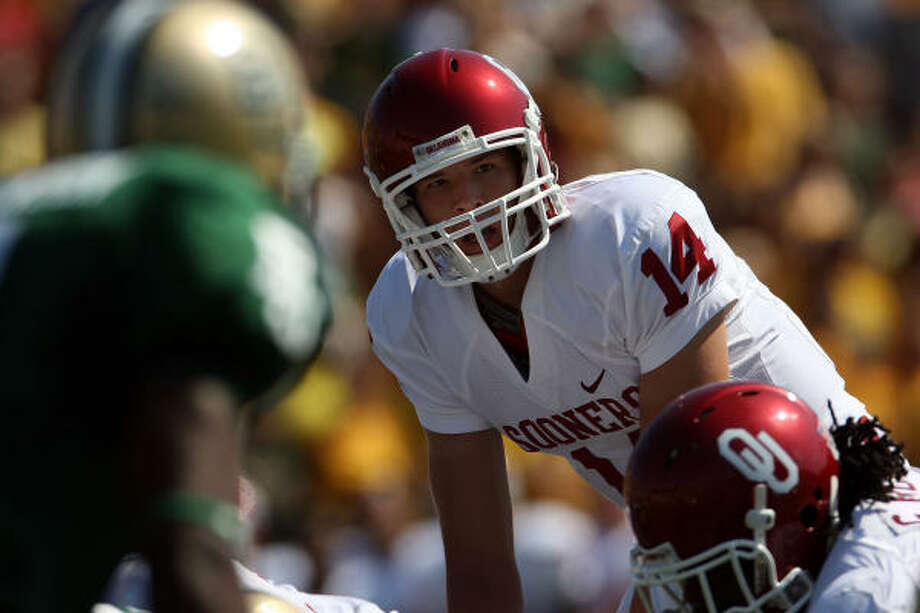 Sooners QB Sam Bradford leads a top-flight offense into Saturday's matchup with the Longhorns. Photo: Ronald Martinez, Getty Images