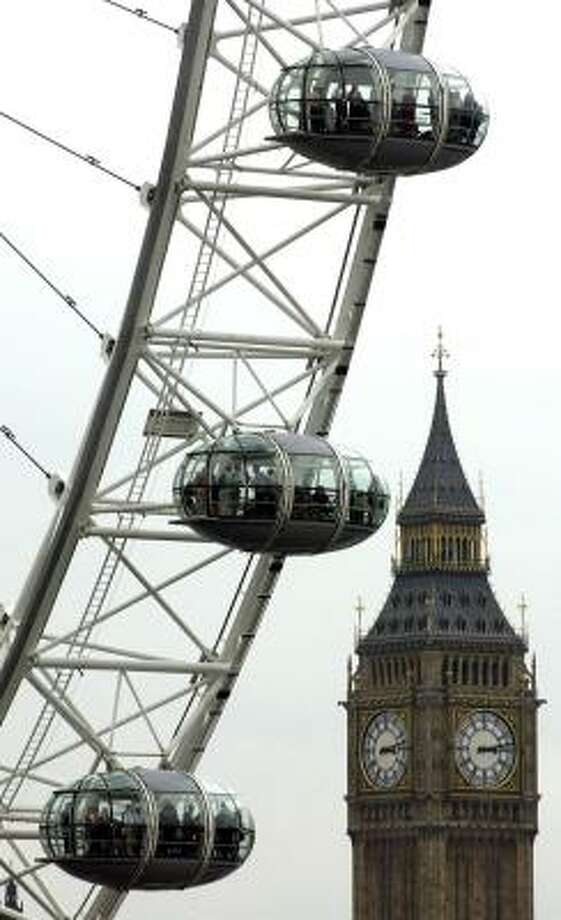 The London Eye, a large Ferris wheel, gives people a bird's eye view of London. Photo: ANNA BRANTHWAITE, ASSOCIATED PRESS