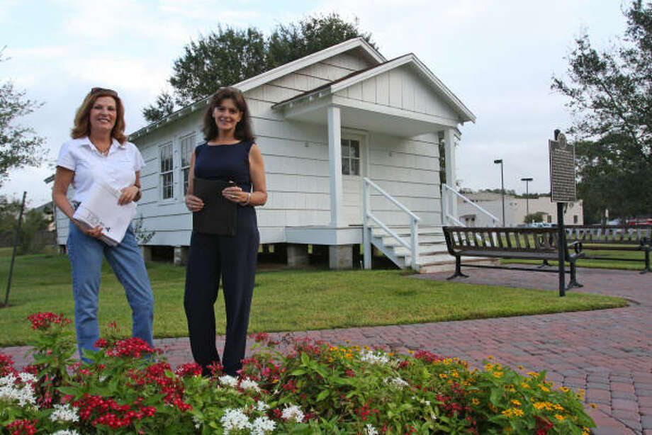 Paula Miller and Carol Adams are working on the refurbishment of the Humble Oil Mess Hall in Katy Heritage Park. Photo: Suzanne Rehak, For The Chronicle