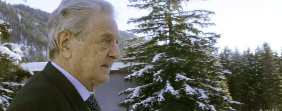 """George Soros advocates the creation of a """"new sheriff"""" for global finance at the World Economic Forum in Davos, Switzerland. Photo: MICHEL EULER, ASSOCIATED PRESS"""
