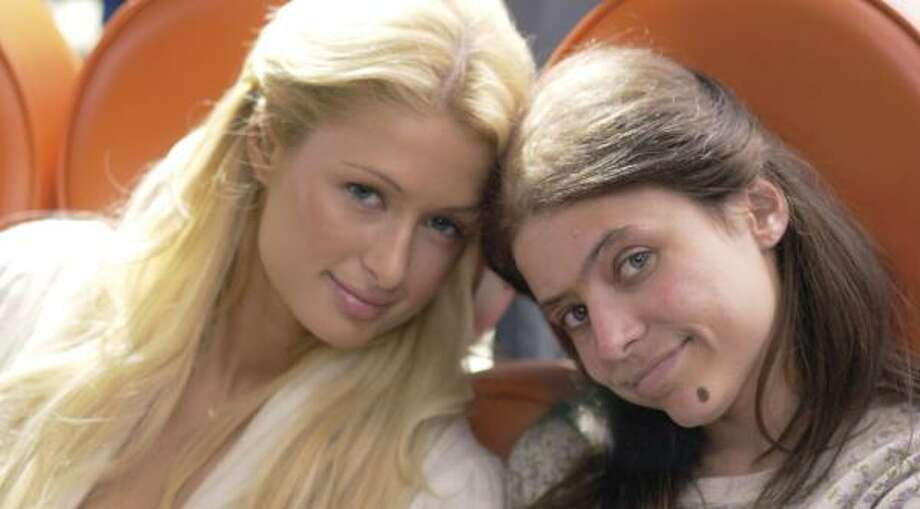 In The Hottie and the Nottie, Cristabelle (Paris Hilton, left) and June (Christine Lakin) are the best of friends. Photo: REGENT RELEASING