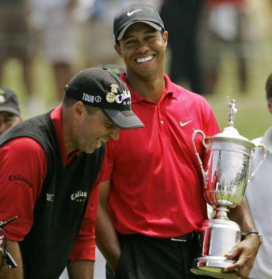 Their 19-hole playoff finally over, Rocco Mediate, left, and Tiger Woods let loose. Photo: CHARLIE RIEDEL, ASSOCIATED PRESS