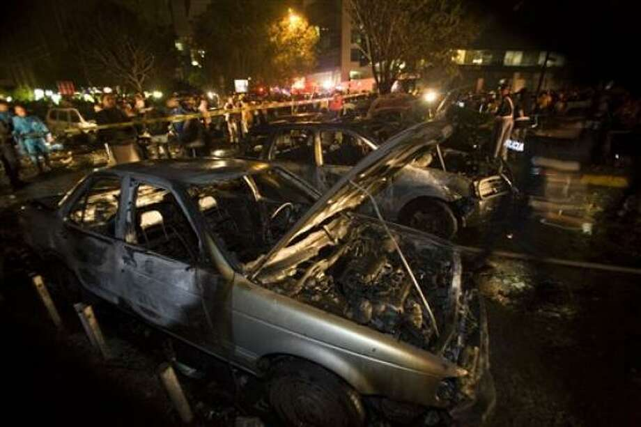 Police cordon an area full of charred cars after a jet crashed during rush hour in Mexico City on Tuesday. Photo: Dario Lopez-MIlls, Associated Press