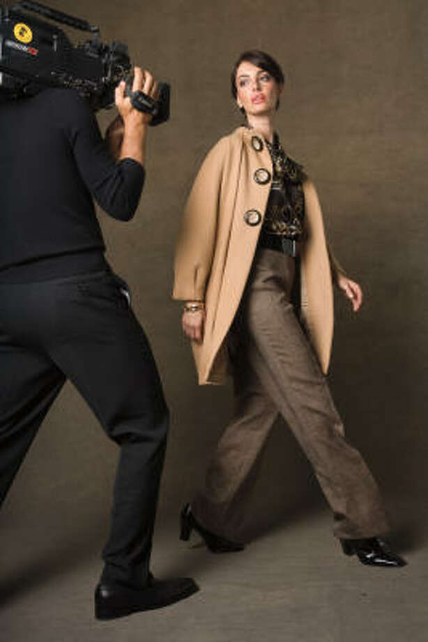 Anne Klein funnel-neck coat with big buttons and a loose cut, is stylish yet durable; $229, Macy's. Photo: Macy's