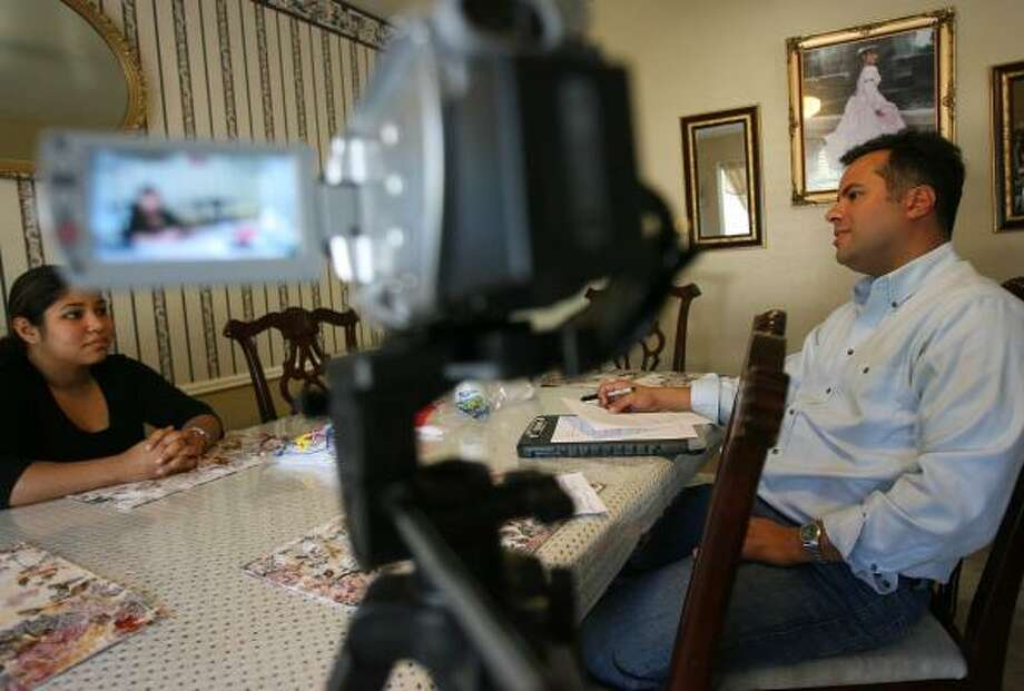 Manuel Delgado, right, interviews Jessica Garcia in her southwest Houston home about her buying habits as a consumer. Photo: MAYRA BELTRÁN, CHRONICLE