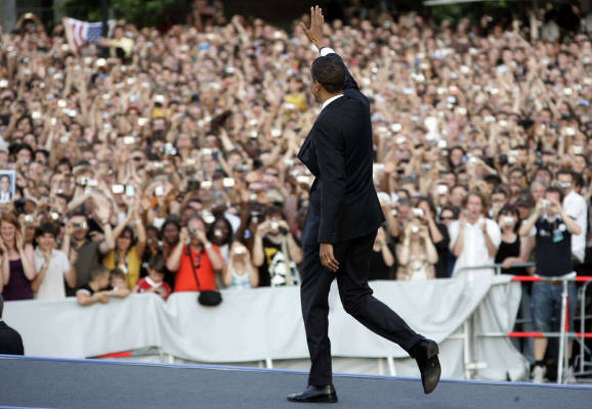 Sen. Barack Obama waves to the crowd before speaking in front of the Siegessaeule at the Grosser Stern in Tiergarten today in Berlin. According to reports, police confirmed that about 200,000 people attended the speech.