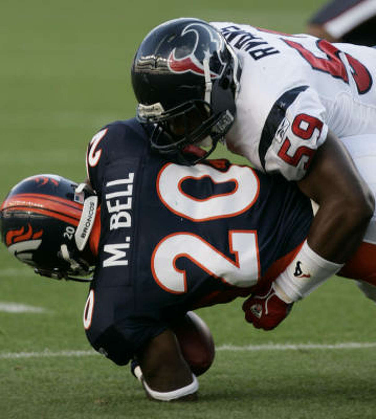 Mike Bell hits the field in Denver during a preseason game against the Texans in 2006.
