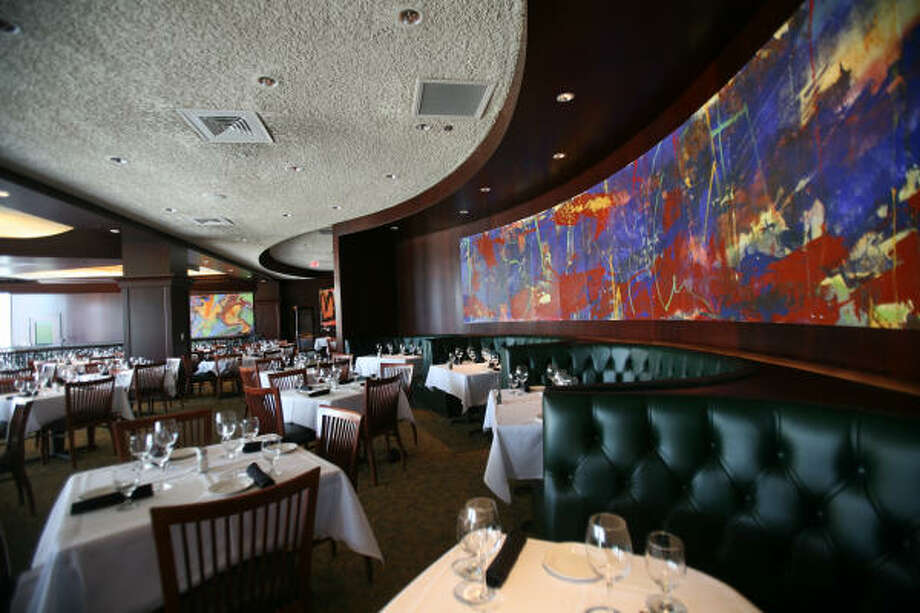 Artwork in the dining area testifies to Del Frisco's sumptuous decor. Photo: Steve Campbell, Chronicle
