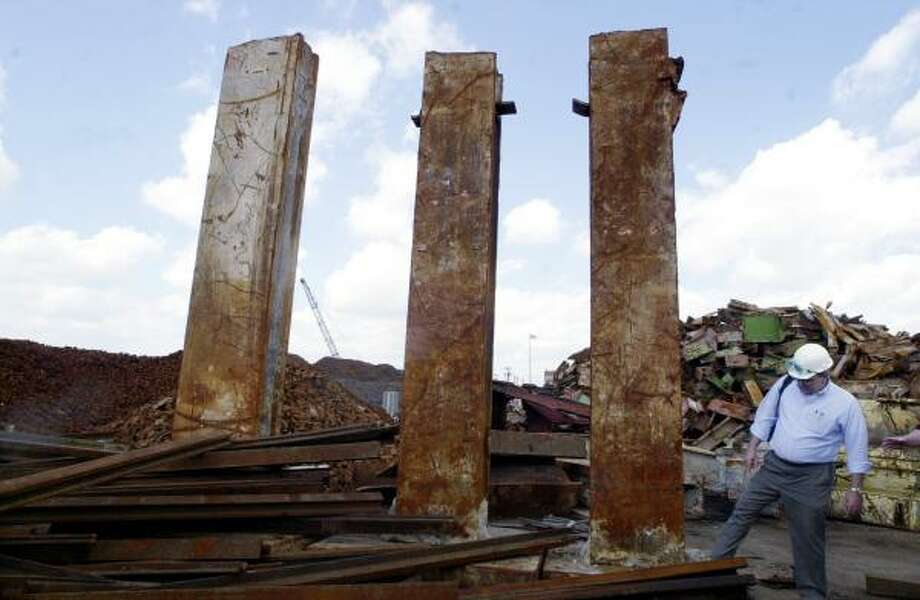 Edward M. DePaola, with the American Society of Civil Engineers, stands next to metal support beams that he said came from under one of the World Trade Center towers. The society has been accused of covering up catastrophic design flaws while investigating national disasters. Photo: MIKE DERER, ASSOCIATED PRESS FILE