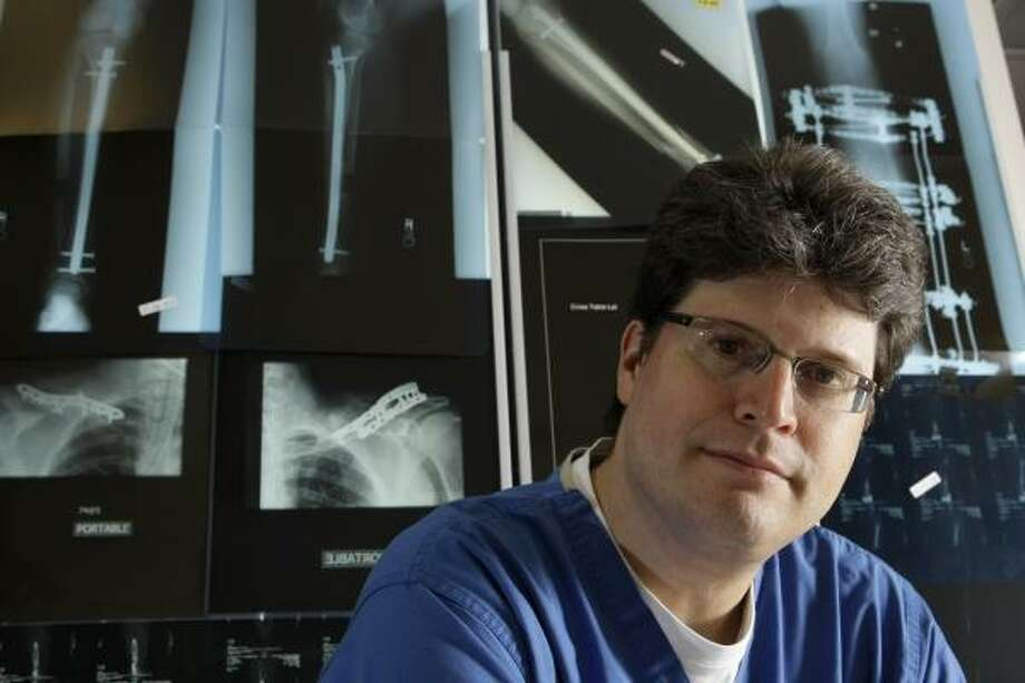 Houston orthopedic surgeon Mark R. Brinker, who co-wrote the screenplay for the Diane Lane thriller Untraceable, already has a second project in the works. Photo: BRETT COOMER, CHRONICLE