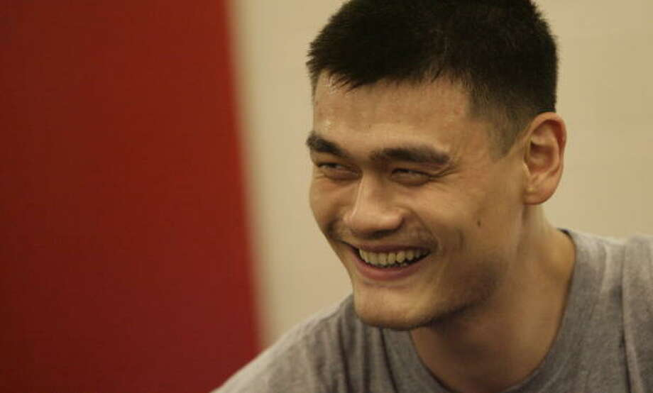 Yao Ming, shown at Toyota Center in April, has started doing contact workouts with the Chinese national team. Photo: Julio Cortez, Chronicle