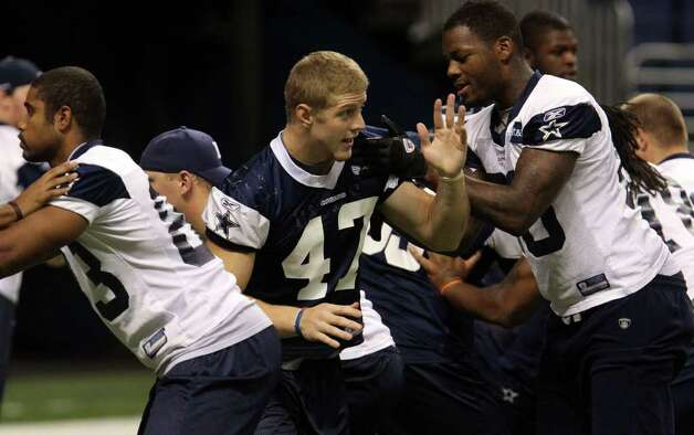 Cowboys linebacker Alex Albright (47, hand raised) goes through walk-through exercises on Monday, Aug. 8, 2011 during training camp at the Alamodome. Photo: John Davenport/jdavenport@express-news.net