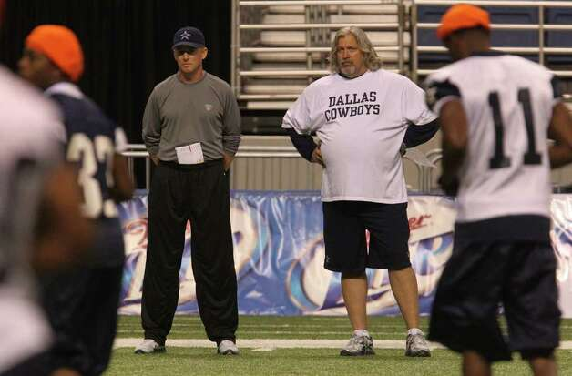 Cowboys head coach Jason Garrett (left) and defensive coordinator Rob Ryan (right) watch as players change positions on the field during walk-through exercises Monday morning, Aug. 8, 2011 during the training camp at the Alamodome. Photo: John Davenport/jdavenport@express-news.net / SAN ANTONIO EXPRESS-NEWS