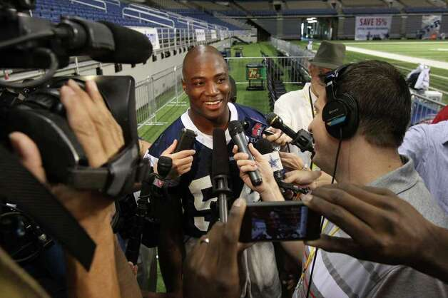 Cowboys linebacker DeMarcus Ware speaks with the press on Monday, Aug. 8, 2011 after walk-through practice during training camp at the Alamodome. Photo: John Davenport/jdavenport@express-news.net