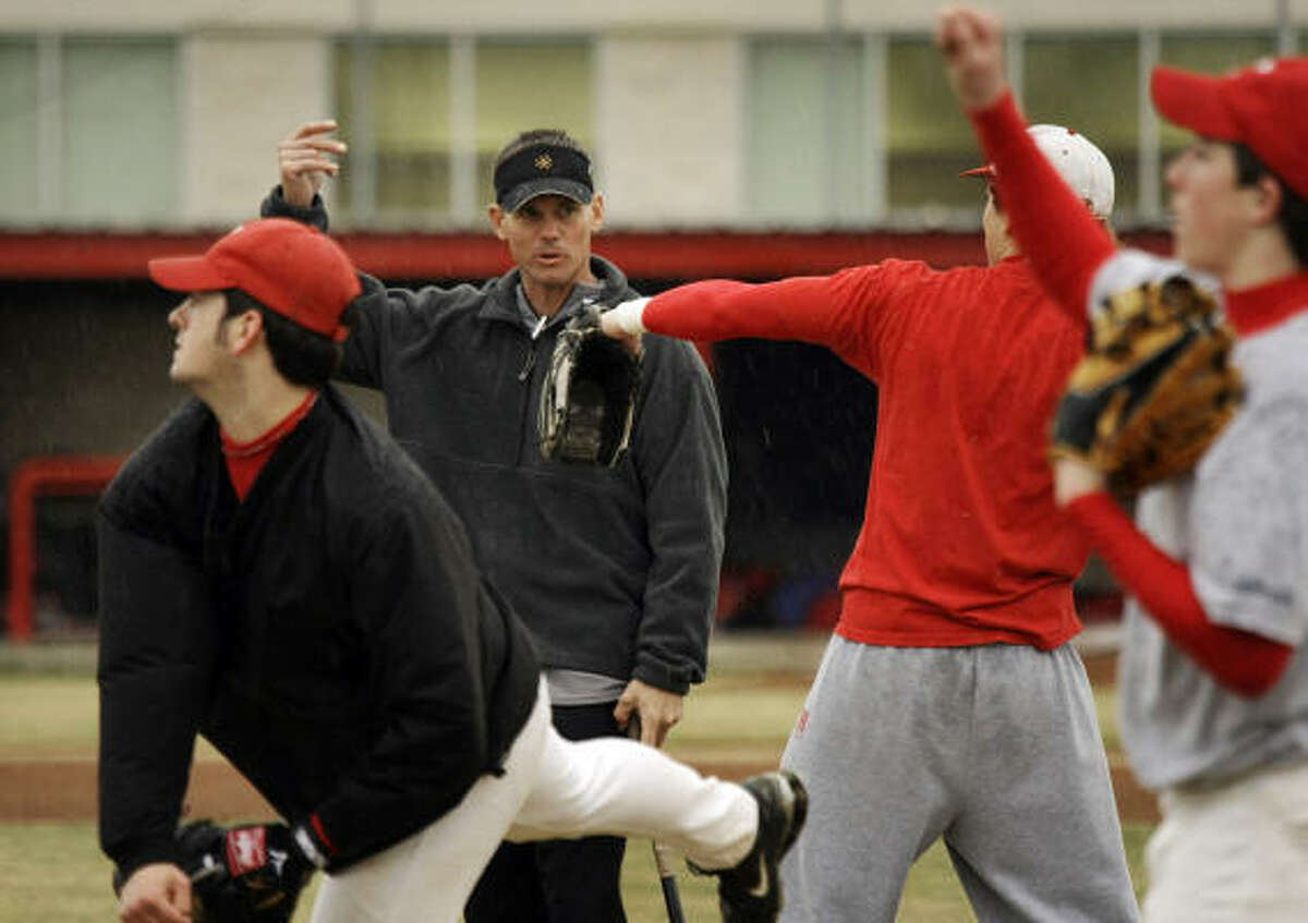 Craig Biggio gives a few pointers to players during baseball team tryouts at at St. Thomas High School in January.