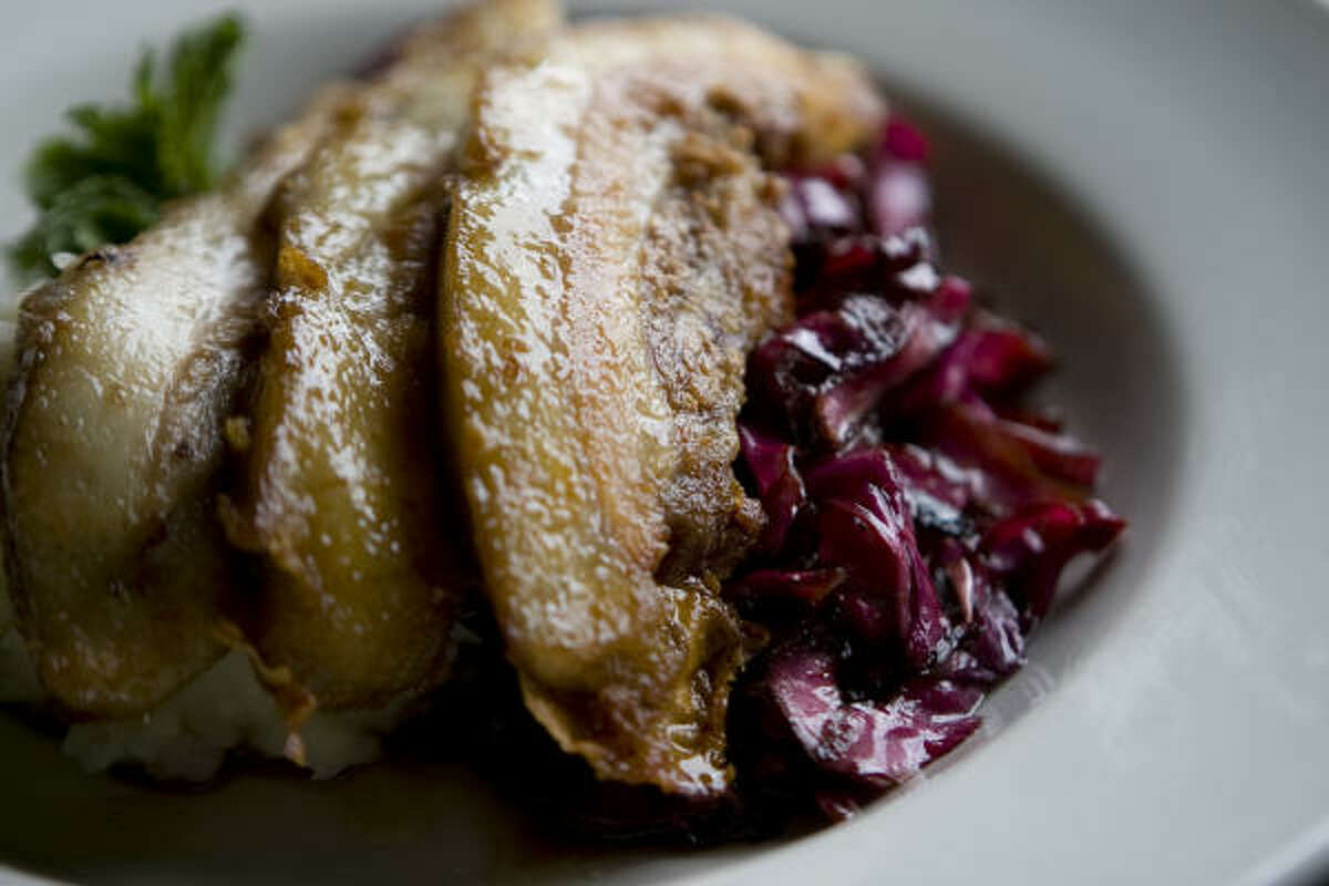 Feast's Pork cheeks are accompanied by winy red cabbage.