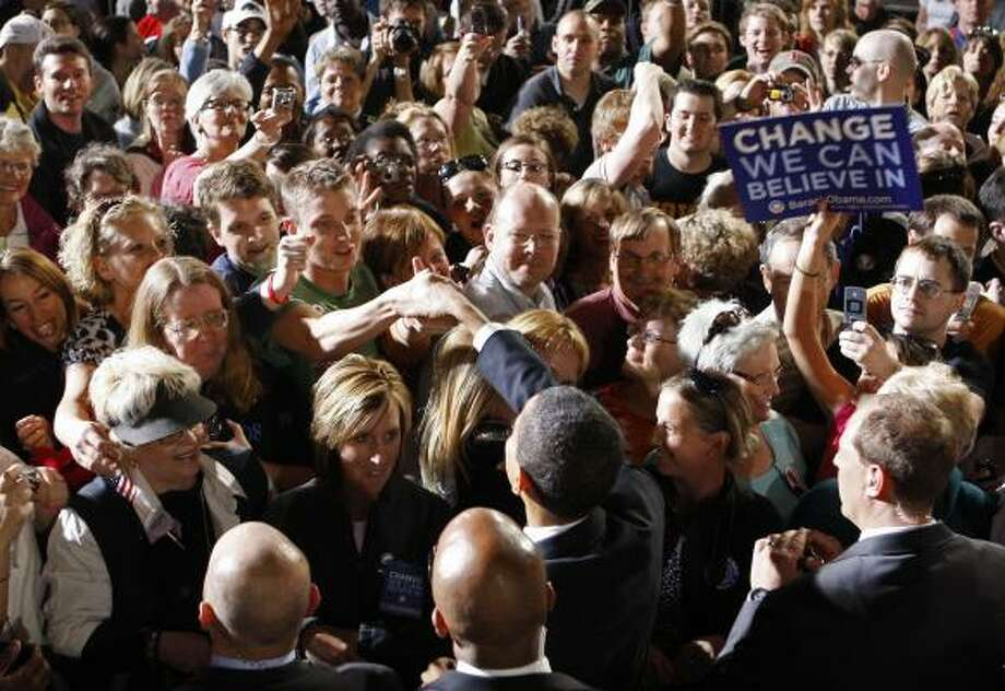 Democratic presidential hopeful, Sen. Barack Obama, D-Ill., greets attendees after a large rally in Des Moines, Iowa, on Tuesday. Photo: Chris Carlson, AP
