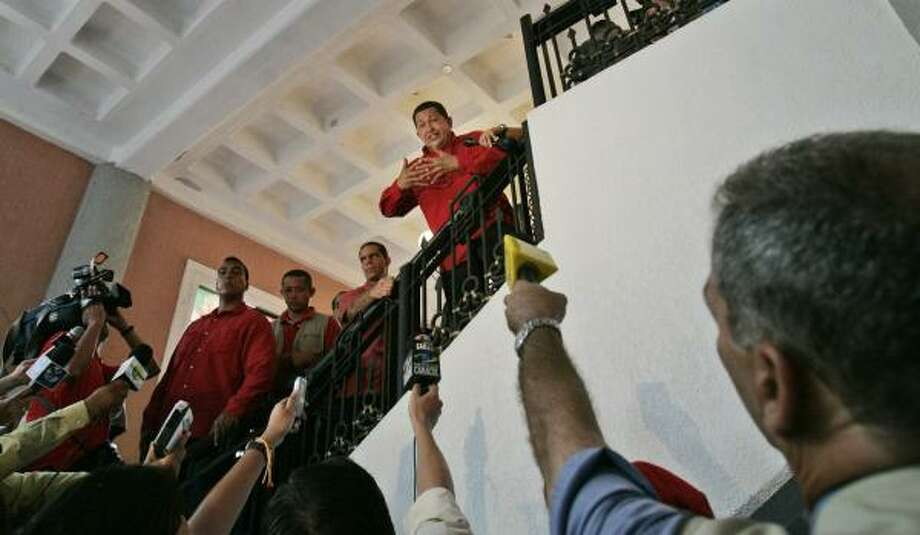 Venezuelan President Hugo Chavez talks to reporters. Analysts say his threat to cut off oil sales to the U.S. makes no economic or political sense for his country. Photo: FERNANDO LLANO, ASSOCIATED PRESS