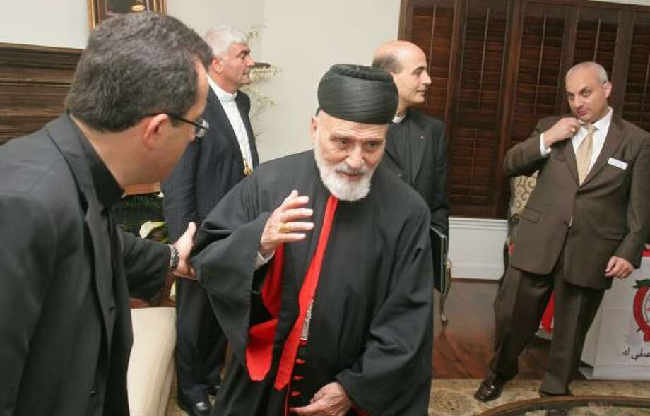 Milad Yaghi, left, pastor of Our Lady of the Cedars Maronite Catholic Church, welcomed Cardinal Nasrallah Peter Sfeir on Monday. Sfeir spoke in Houston before heading to the White House. Photo: GARY FOUNTAIN, FOR THE CHRONICLE