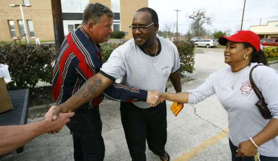 At the Jasper polls Monday, Mitchel Newman, left, who is running for sheriff, got the support of longtime friend Ed Lewis, center. Photo: NICK De La TORRE, CHRONICLE