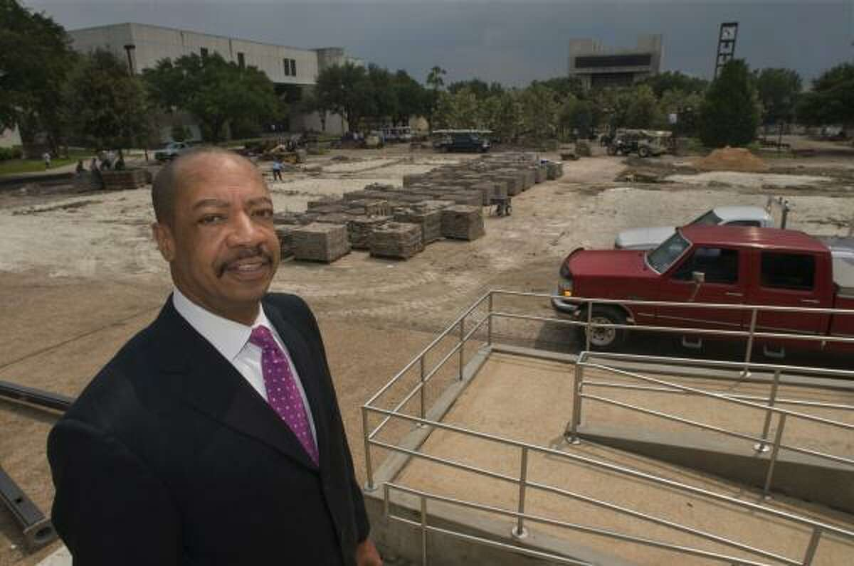 John Rudley, new president at Texas Southern University, looks out over renovations on the campus's central plaza. Rudley has tightened admission standards and hired new administrators.