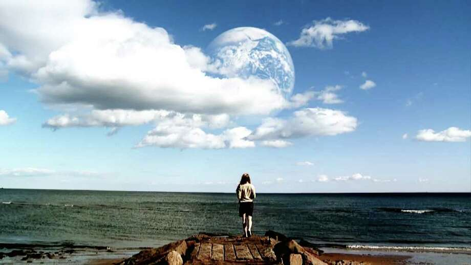 'Another Earth' (2011)Another Earth exactly like our own with identical versions of ourselves is discovered slowly moving closer to our planet. A mission to make contact is planned. This little-seen indie drama is more of a think-piece drama than sci-fi thriller, but it nonetheless leaves audiences wondering what – or who – else might be out there. / © 2011 Twentieth Century Fox Film Corporation