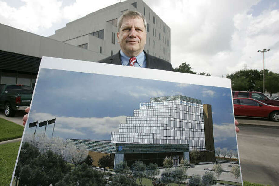 Peter Durkin, chief executive of Planned Parenthood of Houston and Southeast Texas, shows the sketch for the nonprofit's new building on the Gulf Freeway near the University of Houston. Photo: Leonardo Carrizo, Chronicle