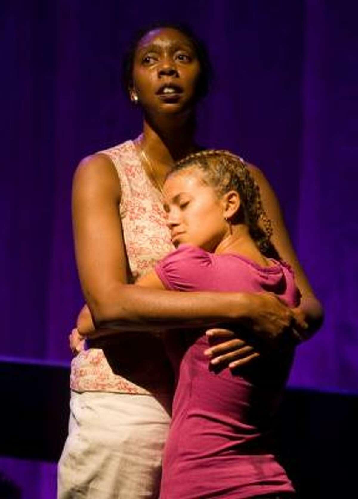 Demetria Thomas (who plays Sharon), left, and Cassandra Rios (Danielle), rehearse a scene from Katrina: The Bridge.