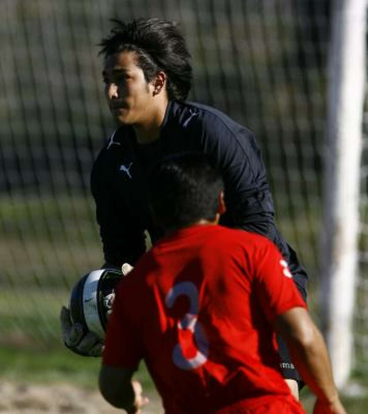 César Omar Hernández, making a save for his team, the Panthers, plays soccer at a private park in north Houston.