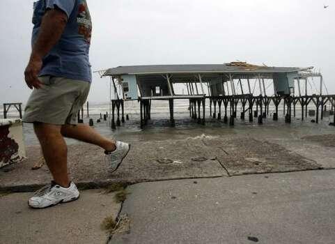Hurricane Ike left remnants of Murdoch's Pier standing along Seawall Boulevard. Longtime resident Dorothy Davison spent lots of time at Murdoch's and the Balinese Room. Photo: JOHNNY HANSON, HOUSTON CHRONICLE