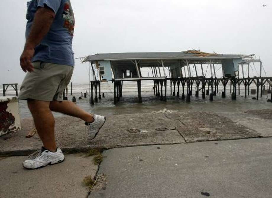 Hurricane Ike left remnants of Murdoch's Pier standing along Seawall Boulevard. Longtime resident Dorothy Davison spent lots of time at Murdoch's and the Balinese Room. Photo: JOHNNY HANSON, HOUSTON CHRONICLE