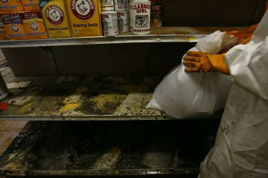 Mold coats the shelves of Maya's Grocery in Galveston on Saturday as the Ochoa family cleans up from the storm. Photo: SHARON STEINMANN, CHRONICLE